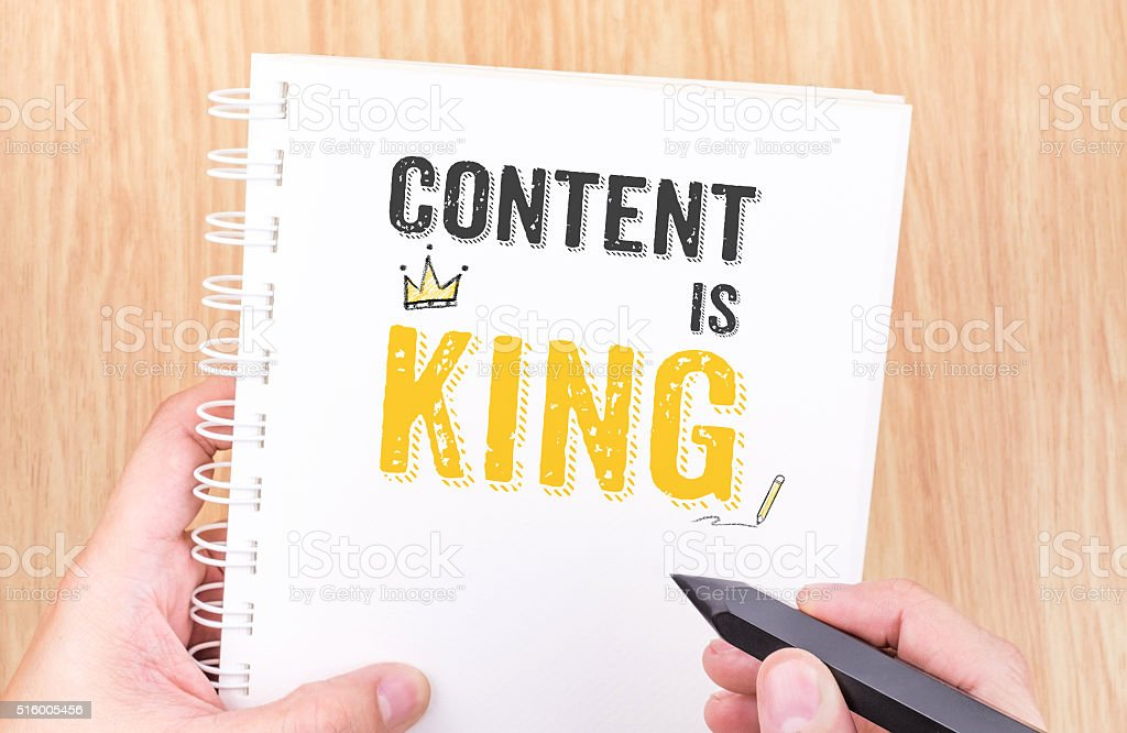 Content is King work on white ring binder notebook stock photo