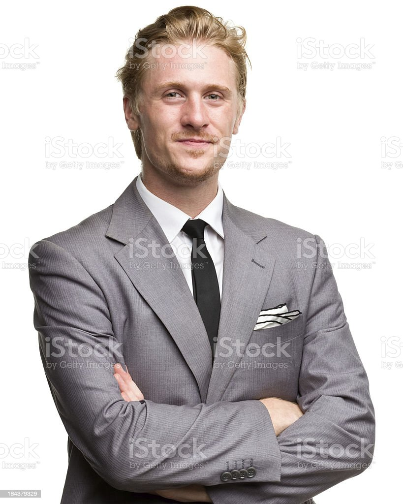 Content Man In Suit With Arms Crossed stock photo