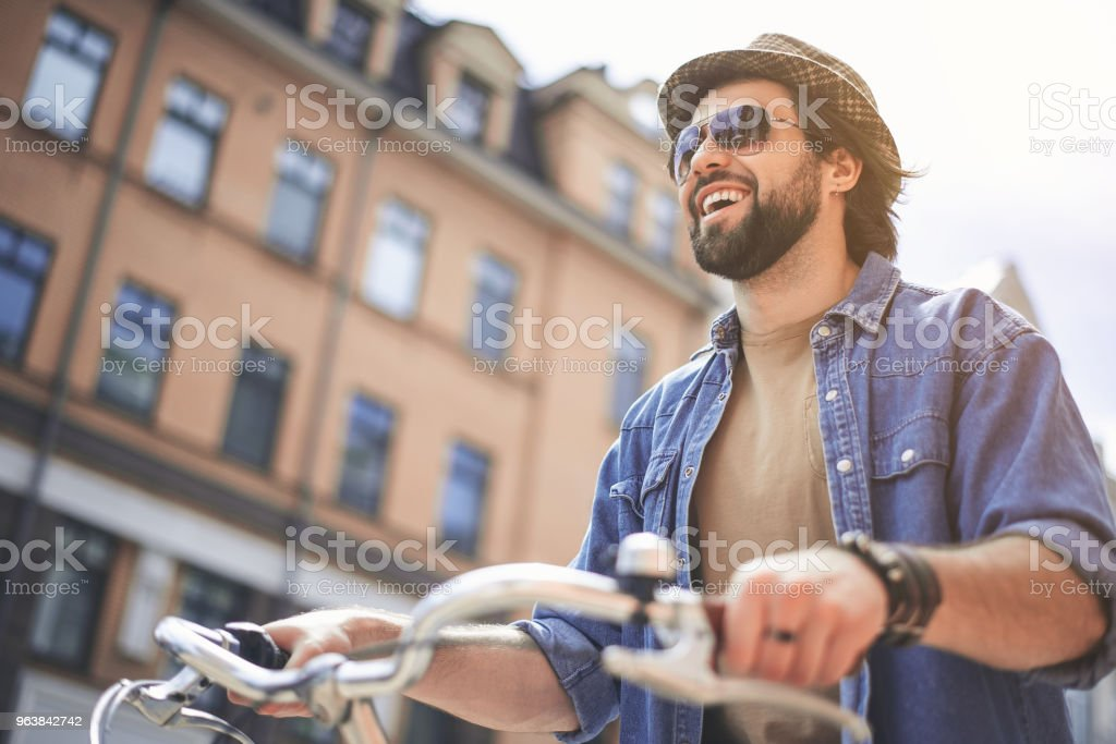 Content man riding bike at high speed - Royalty-free Adult Stock Photo