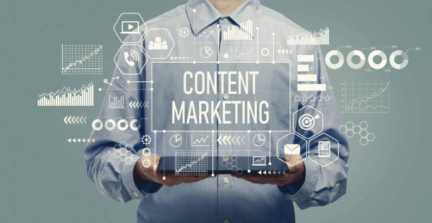 Content marketing concept with man holding a tablet