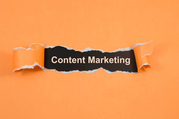 Content Marketing text on paper. Word Content Marketing on torn paper. Concept Image. stock photo