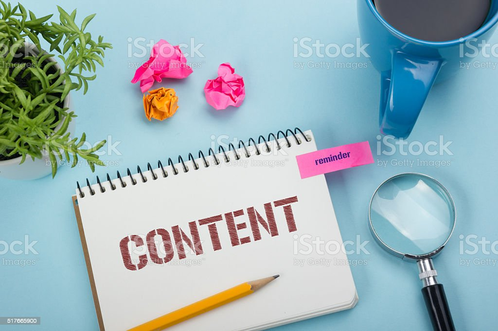 Content, online concept. Notepad with message, pen, coffee cup and stock photo