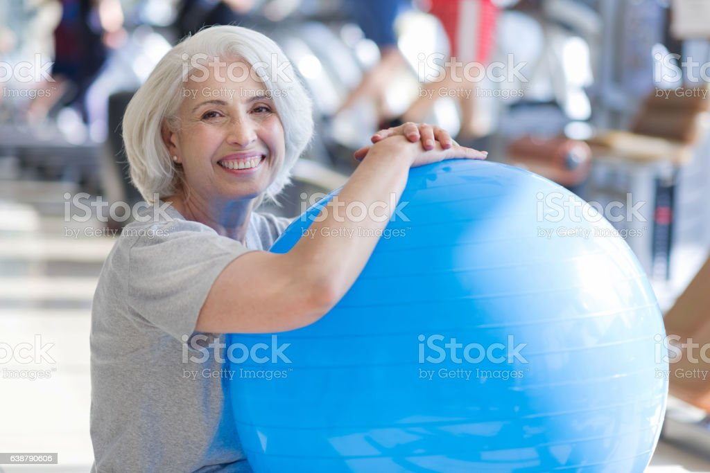 Content smiling woman sitting on a floor stock photo