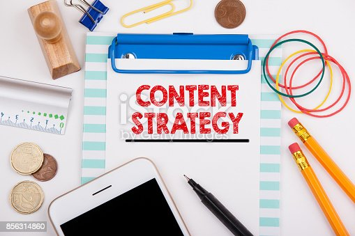 1125093513 istock photo content strategy. Marketing, Social Media Advertising and Branding Concept. Office desk with stationery and mobile phone 856314860