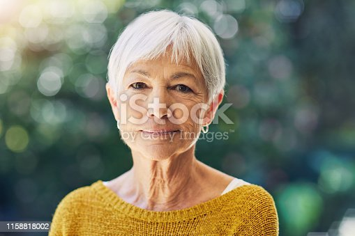 Shot of a confident senior woman standing outdoors
