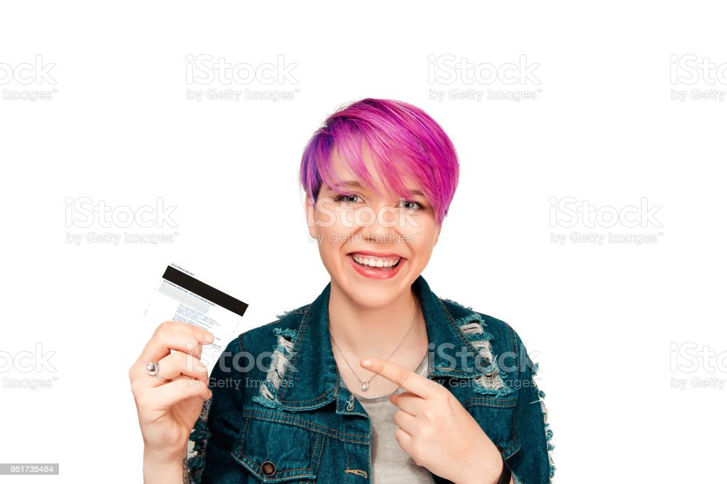 Content woman showing credit card stock photo