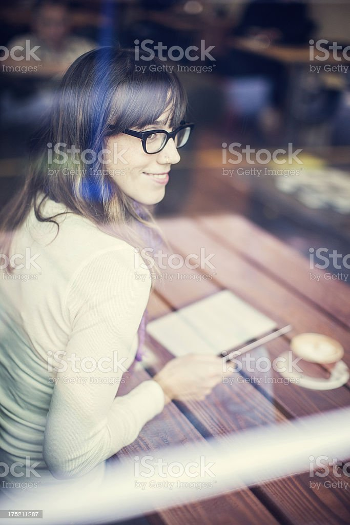 Content Woman with Tablet Computer in Cafe royalty-free stock photo