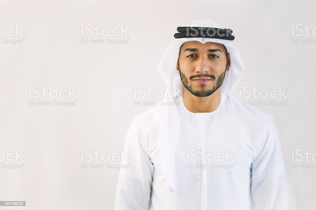 Content Young Arab Man in Traditional Clothing stock photo