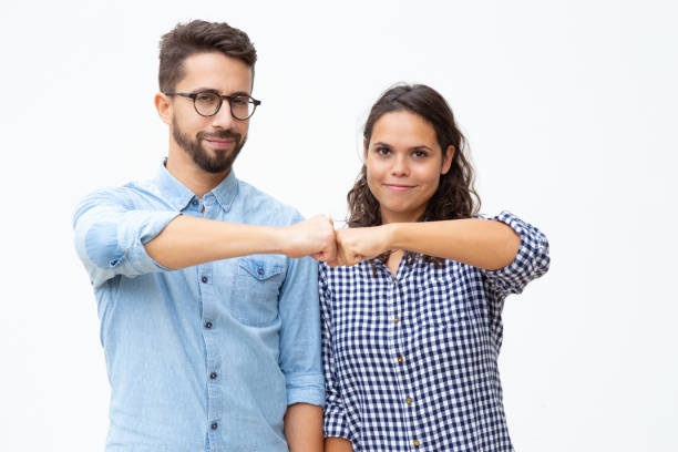Content young couple touching fists stock photo