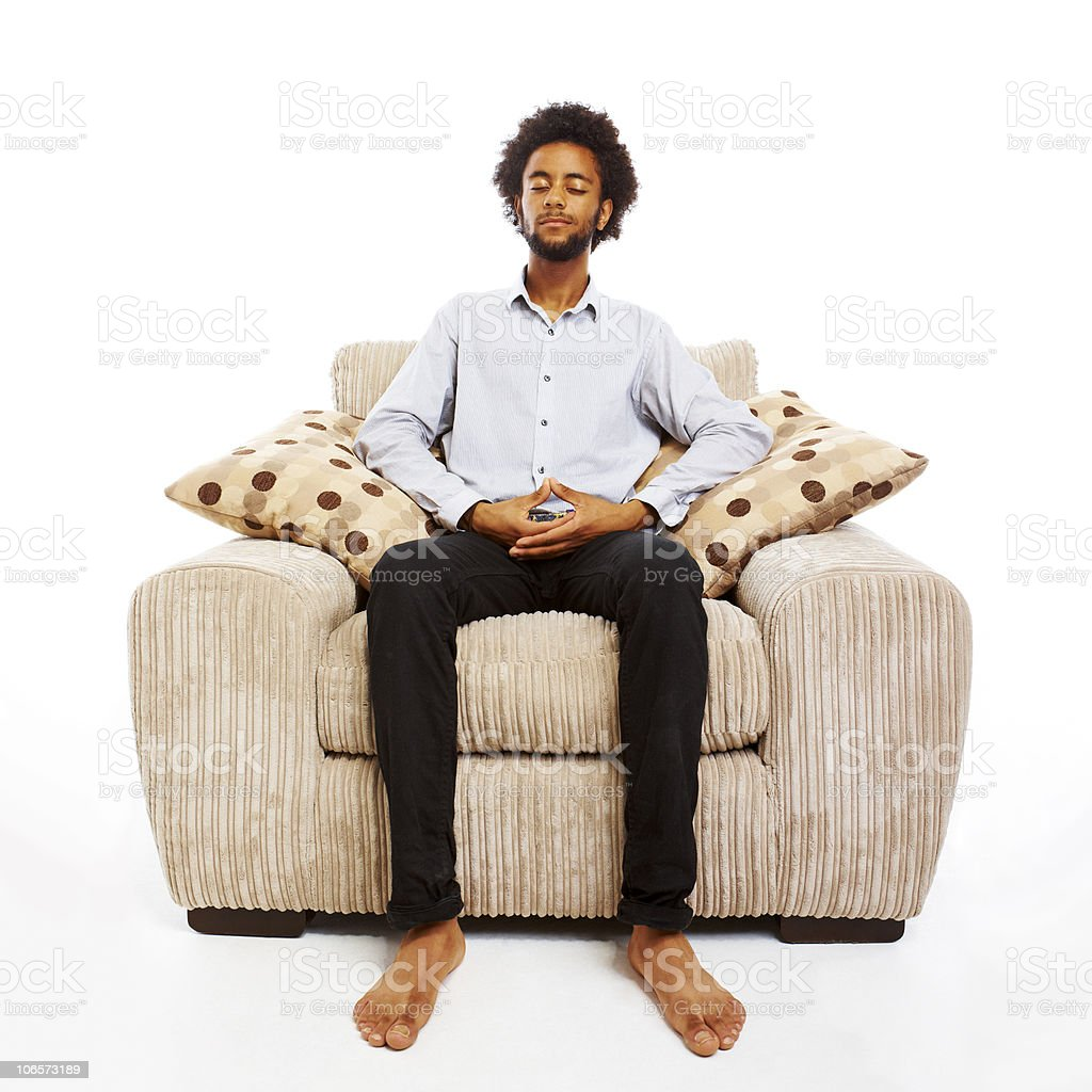 Sitting Chair: Content Young Man Sitting Meditating In Comfy Chair On
