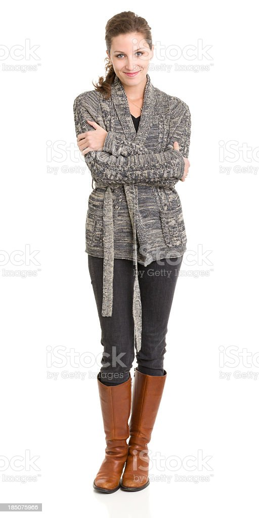 Content Young Woman Standing With Arms Crossed stock photo