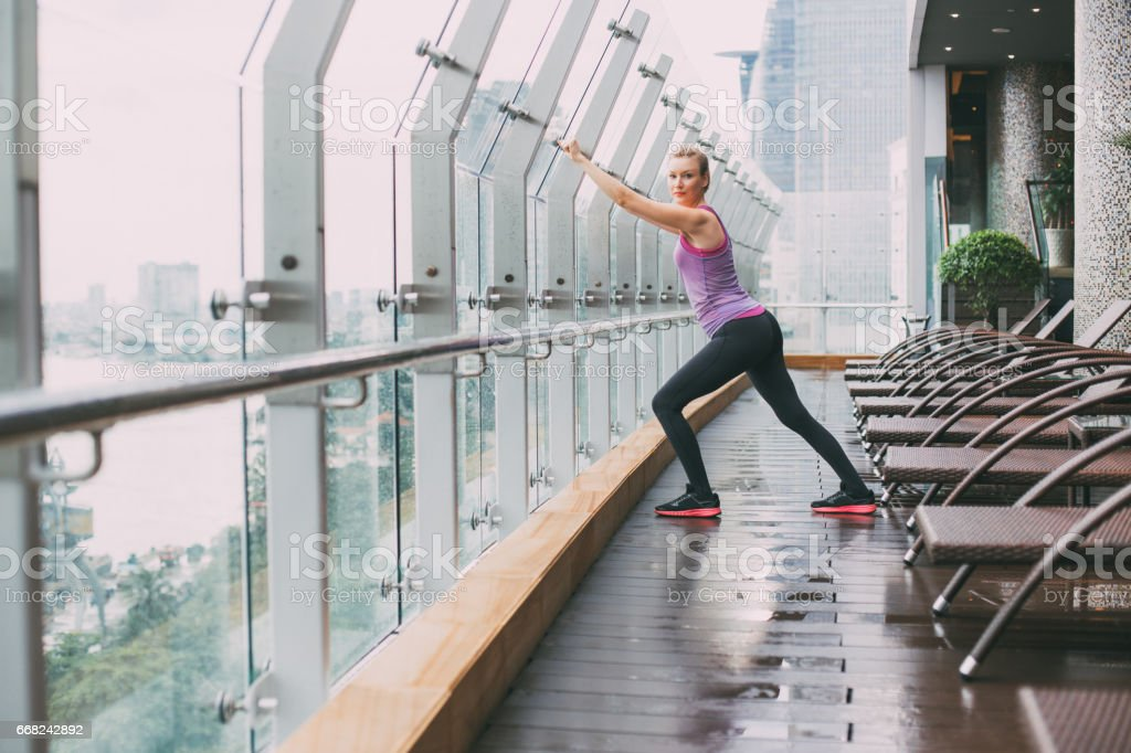 Content young women stretching on balcony stock photo