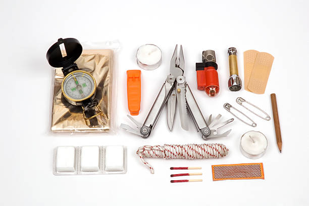 Contents of a survival kit on display stock photo