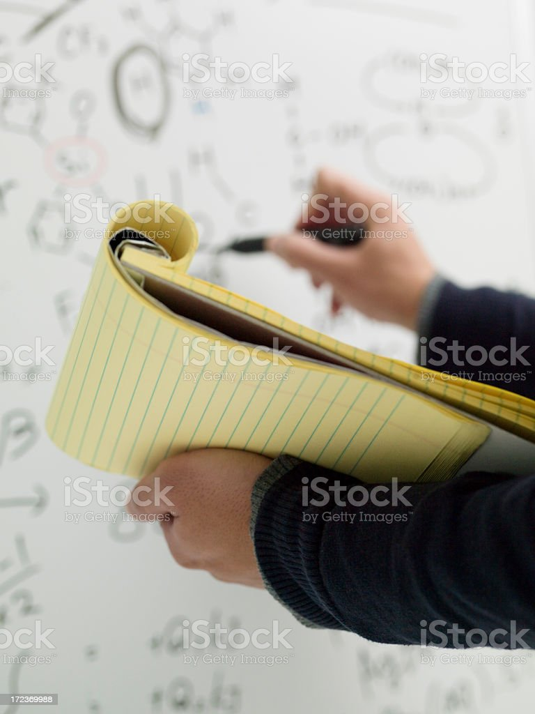 Contents of the whiteboard notes are transcribed by men. royalty-free stock photo