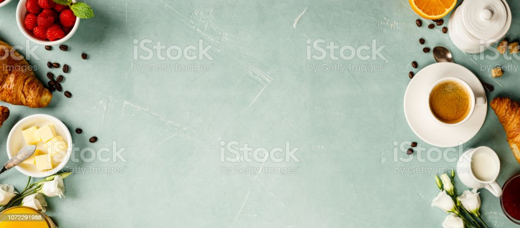 Continental breakfast captured from above - on blue concrete background stock photo
