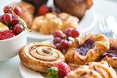 istock Continental Breakfast - Cinnamon Bun, Danishes, Rolls, Muffins, Fresh Fruit 491699034