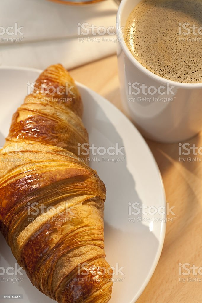 Continental Breakfast Croissant and Cup Of Coffee royalty-free stock photo