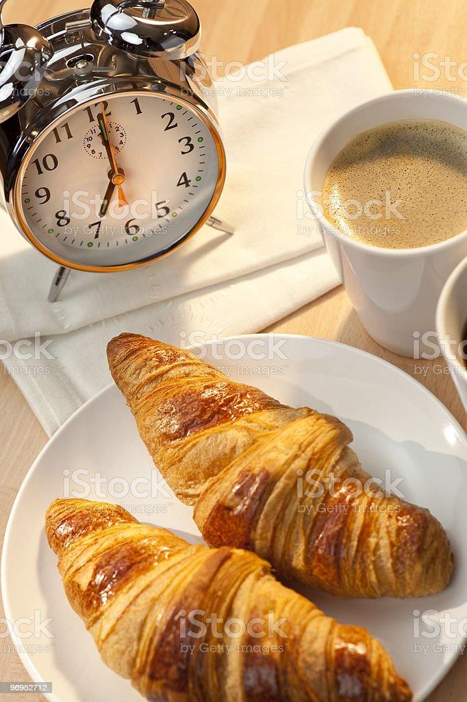 Continental Breakfast Croissant, Coffee, Napkins & Alarm Clock royalty-free stock photo