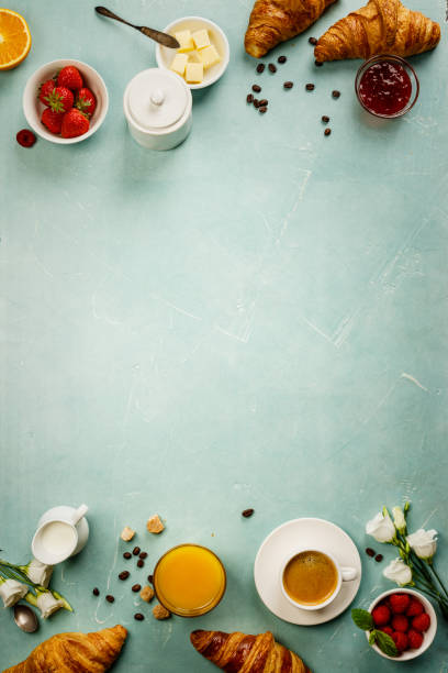 Continental breakfast on blue background captured from above stock photo