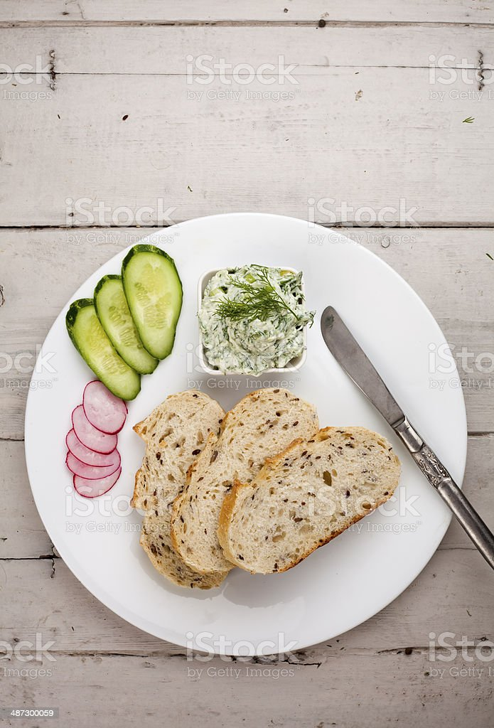 Continental breakfast with bread cottage cheese and herbs stock photo