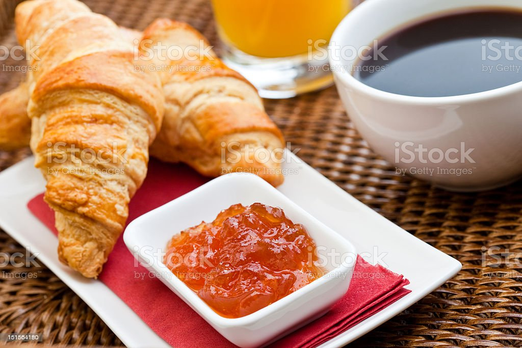 Continental breakfast with croissant & coffee royalty-free stock photo