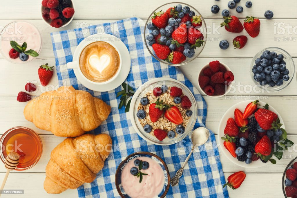 Continental breakfast with croissants and berries on checkered c stock photo