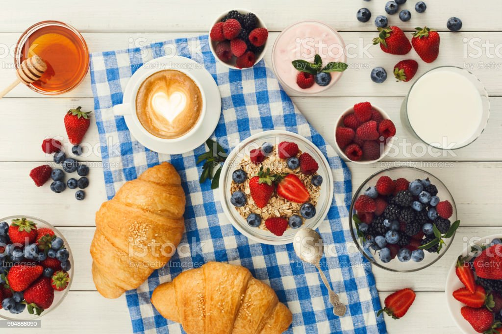 Continental breakfast with croissants and berries on checkered c royalty-free stock photo