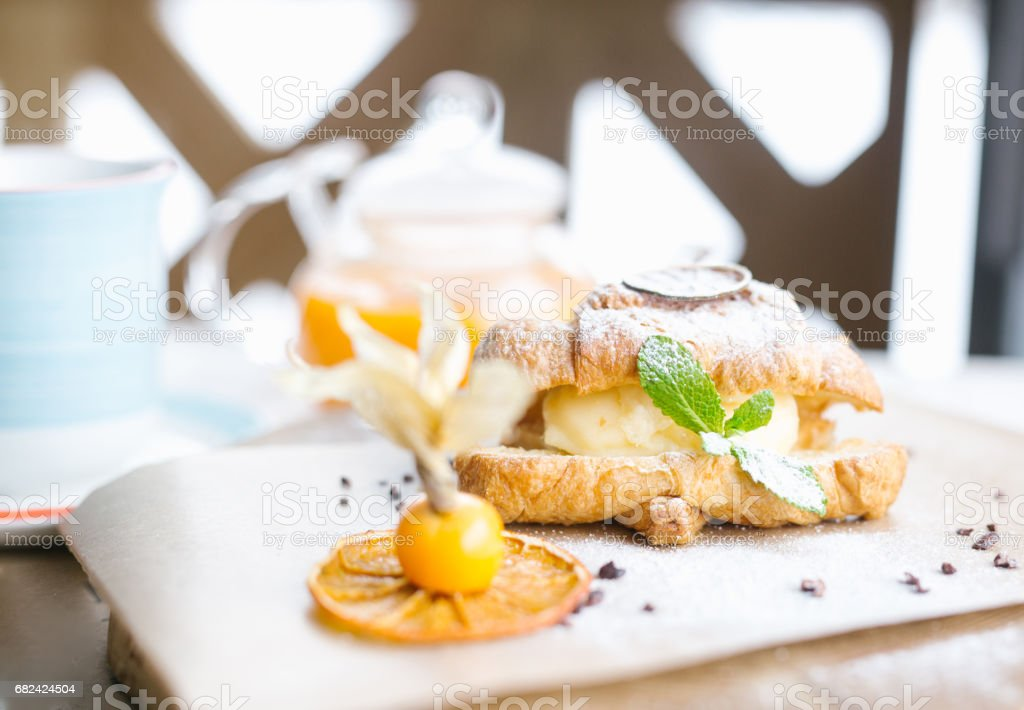Continental breakfast with croissants, orange juice and coffee or tea stock photo