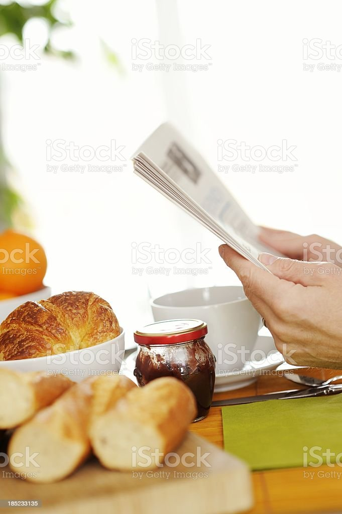 Continental Breakfast with Newspaper royalty-free stock photo