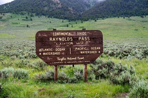 Continental Divide - Raynolds Pass sign in the Targhee National Forest on the Idaho and Montana border along Highway 87