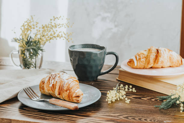 Continental traditional breakfast with croissants and coffee stock photo