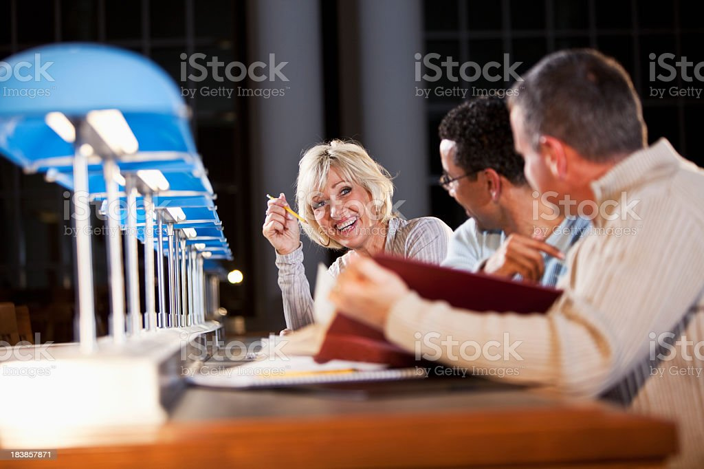 Continuing education, adult students studying royalty-free stock photo