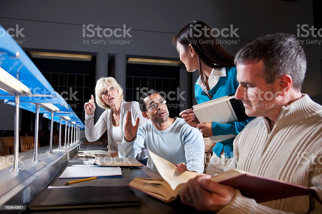 Continuing education, confused adult students with instructor stock photo