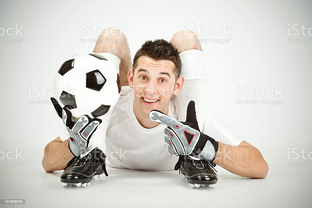 Contorsionist flexible soccer football goalkeeper player show ball royalty-free stock photo
