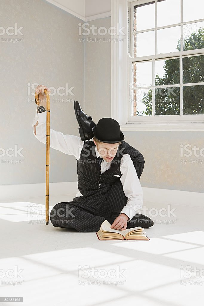 Contortionist reading a book royalty-free stock photo