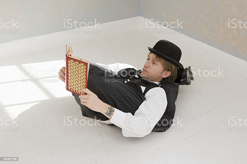 Contortionist reading a book royalty-free 스톡 사진