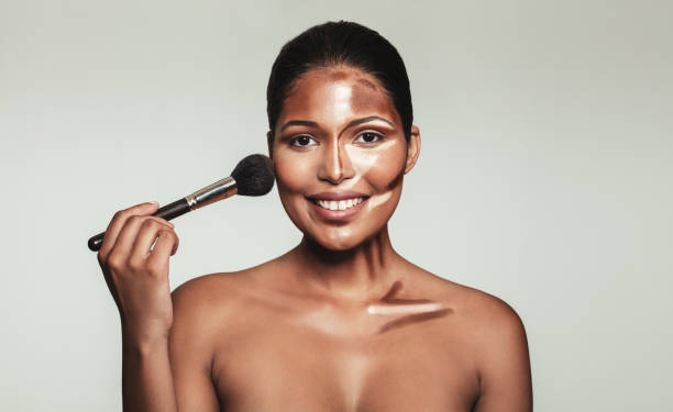 Contour and highlight makeup on female model face - foto stock