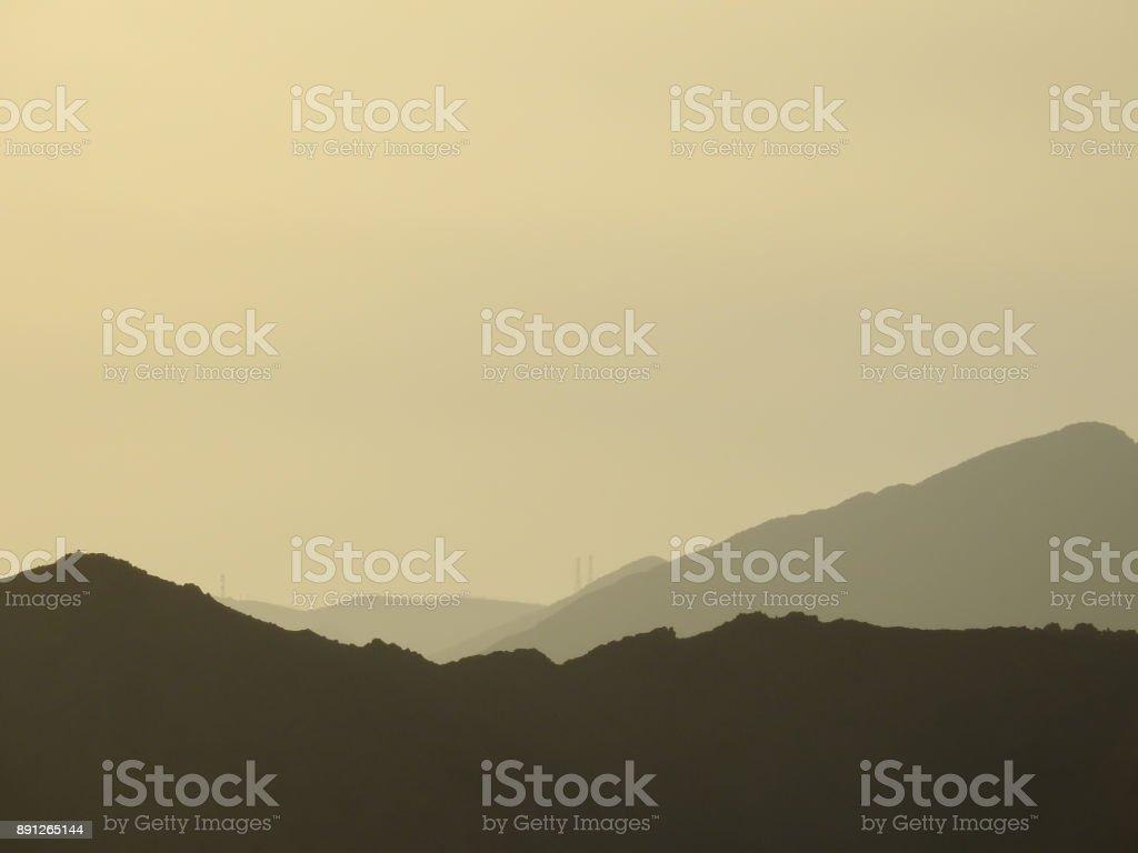 Contour of the Hajjar mountains on the horizon at sunset. Sultanate of Oman stock photo