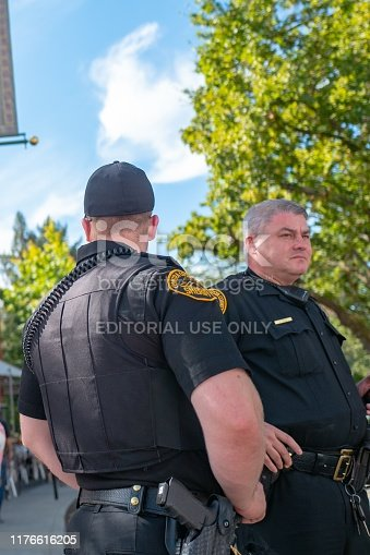 Lafayette, California, United States - September 22, 2019:  Two Contra Costa County sheriff deputies, police officers, stand watch over an event in Lafayette, California, September 22, 2019