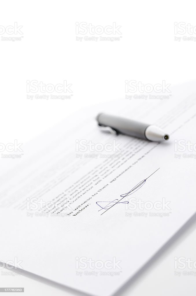 Contract and a pen royalty-free stock photo