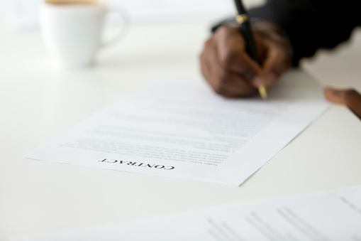 843533912 istock photo Contract close up view, african businessman signing business legal paper 916520048