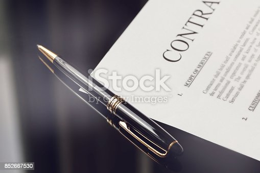 istock contract documents and fountain pen on black desk, business concepts 852667530