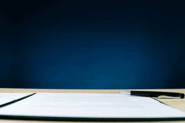 Contract in folder an a pen lying on office desk stock photo