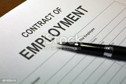Someone filling out Contract of Employment.