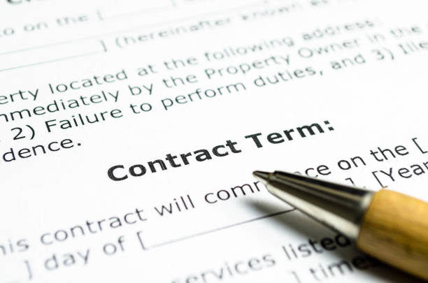 Contract term with wooden pen Contract term with wooden pen agreement stock pictures, royalty-free photos & images