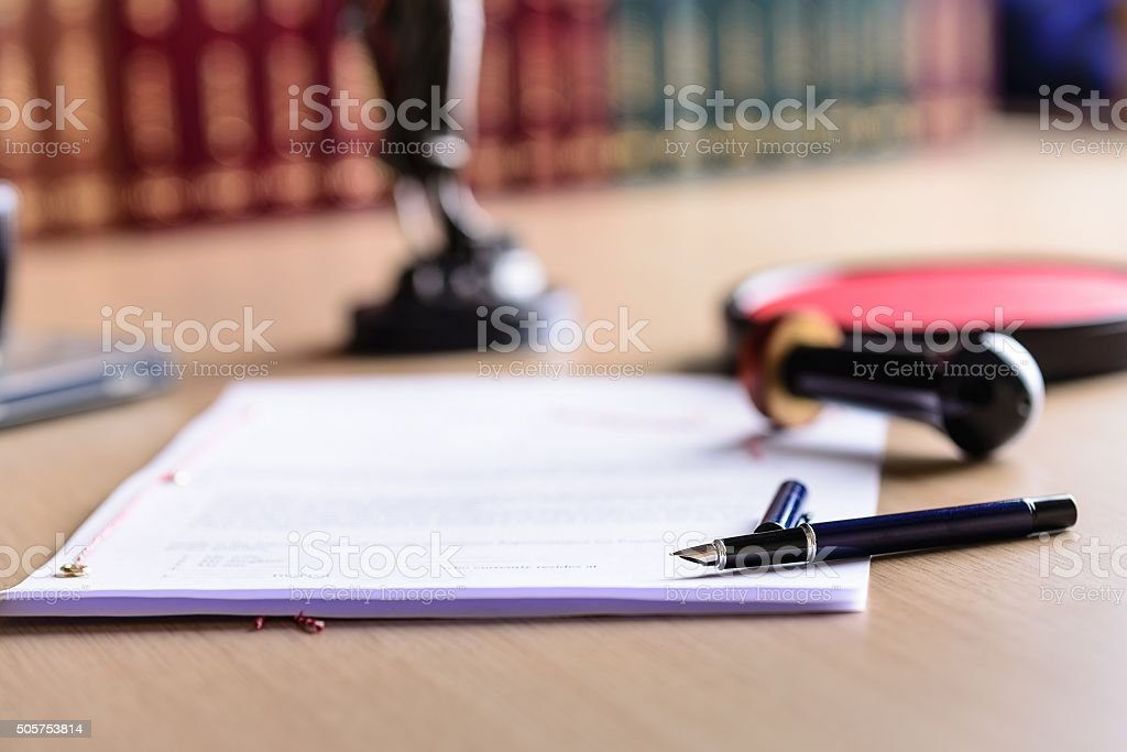 Contract waiting for a notary public sign on desk. stock photo
