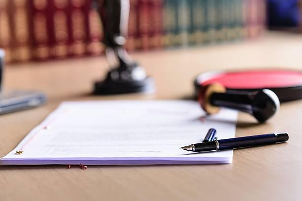 contract waiting for a notary public sign on desk. - notaris stockfoto's en -beelden