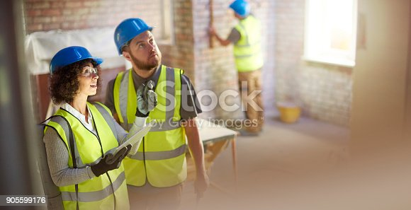istock contractor and building inspector 905599176