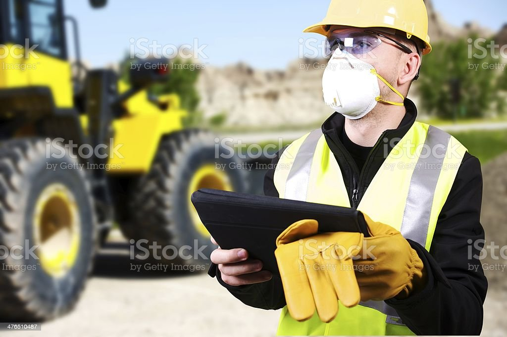 Contractor and Bulldozer royalty-free stock photo