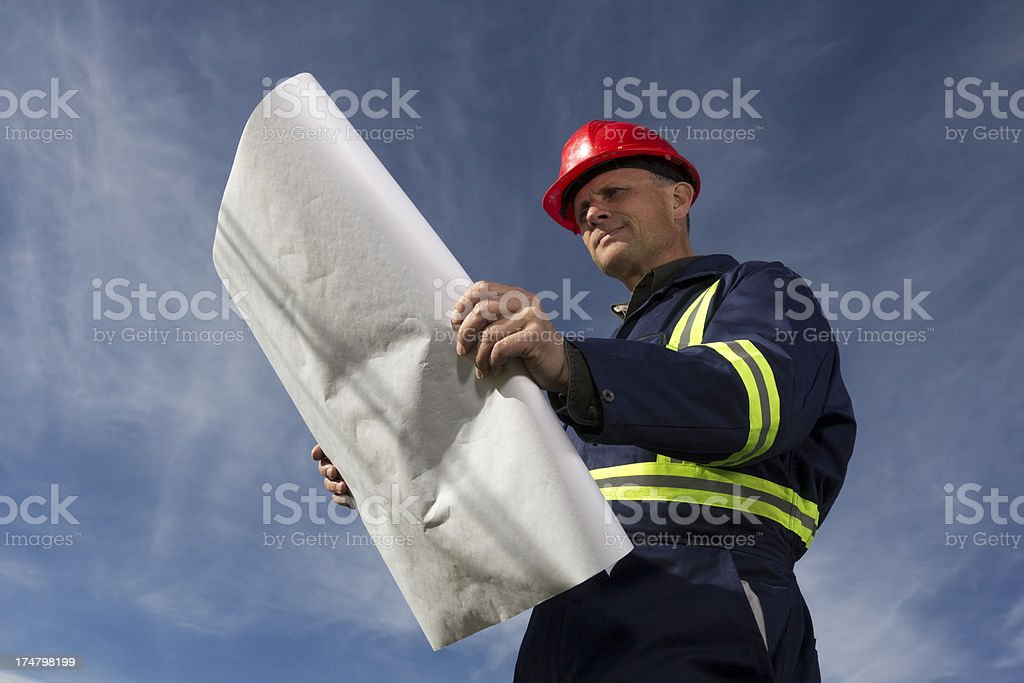 Contractor and Plans royalty-free stock photo